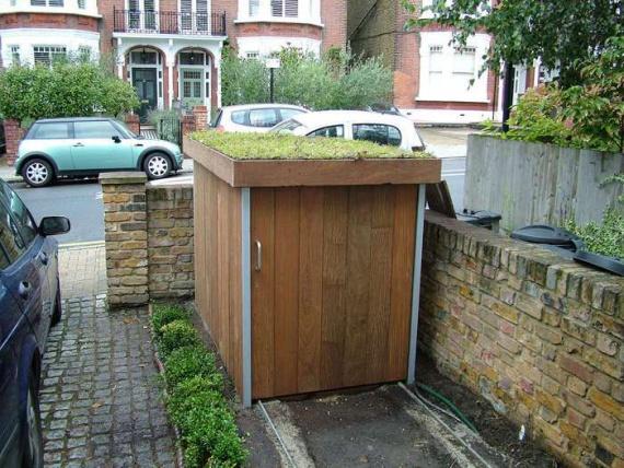 Как построить гараж для велосипедов с зеленой крышей